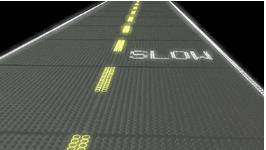 ▲LED发光层产生的智能路面指示灯